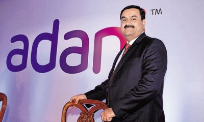 Adani to join hands with Total for fuel retail, LNG terminals